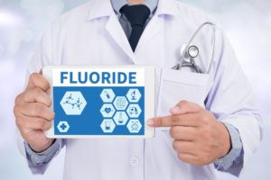 doctor pointing to fluoride on a tablet