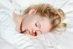 sleeping child sucking their thumb